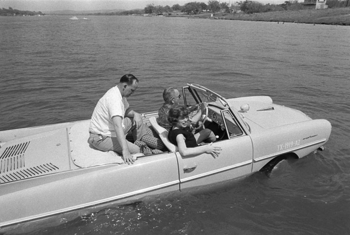 LBJ with friends, taking a spin in a lake in his Amphicar