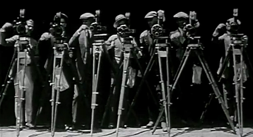 A photo of a line of silent movie camera operators