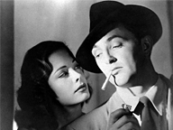 Robert Mitchum as Philip Marlowe-esque detective in Out of the Past